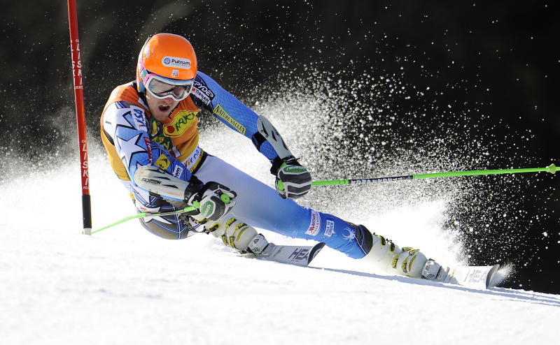Ted Ligety, of the United States, powers past a gate during the first run of an alpine ski, men's World Cup giant slalom in Kranjska Gora, Slovenia, Saturday, March 10, 2012. (AP Photo/Elvis Piazzi)