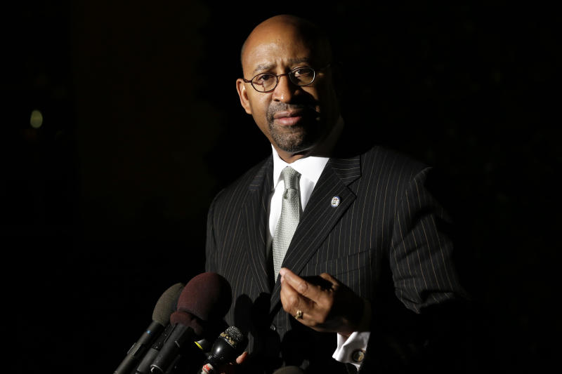 Philadelphia Mayor Michael Nutter speaks to the media outside of the White House, after Vice President Biden met with mayors from cities across the country to talk about taxes and the economy, in Washington, Thursday, Nov. 15, 2012. (AP Photo/Jacquelyn Martin)