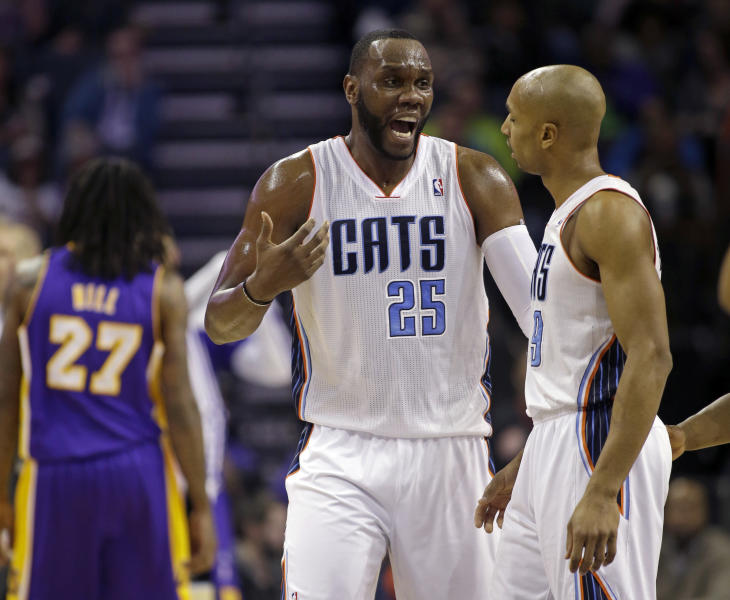 Charlotte Bobcats' Al Jefferson (25) talks with teammate Gerald Henderson (9) during the first half of an NBA basketball game against the Los Angles Lakers in Charlotte, N.C., Saturday, Dec. 14, 2013. (AP Photo/Bob Leverone)