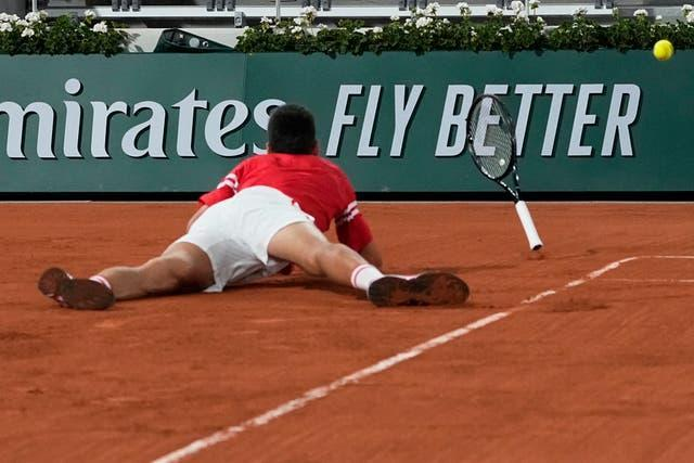 Novak Djokovic fell to the clay during the fourth set