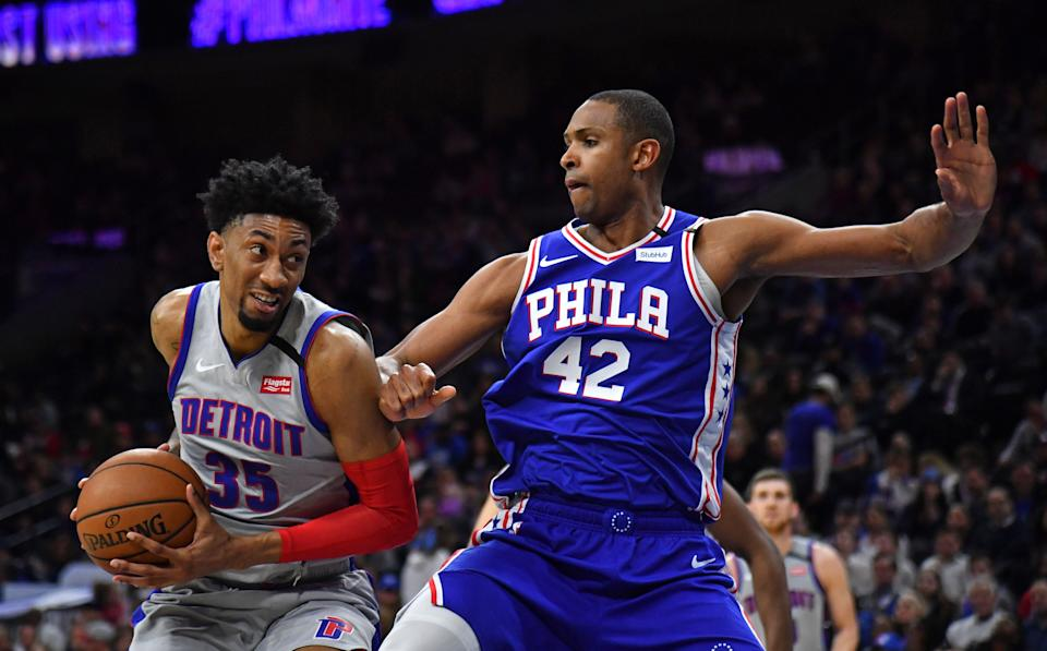 Christian Wood drives to the basket against Philadelphia's Al Horford on March 11, 2020.