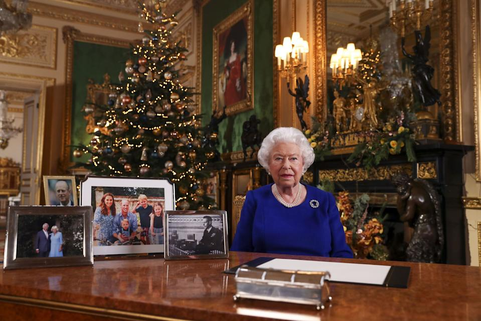 Queen Elizabeth sits at her desk for her annual Christmas address.