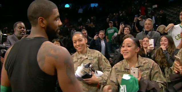 Kyrie Irving shakes the hands of two members of the United States Armed Forces after giving them his game-worn sneakers and jersey. (Screencap via NBC Sports Boston)