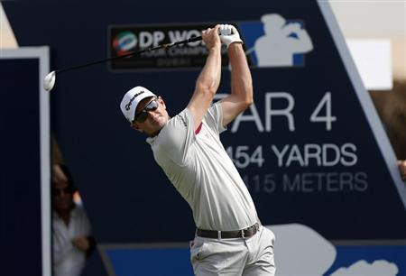 Rose of England tees off on the first hole during the DP World Tour Championship golf tournament in Dubai