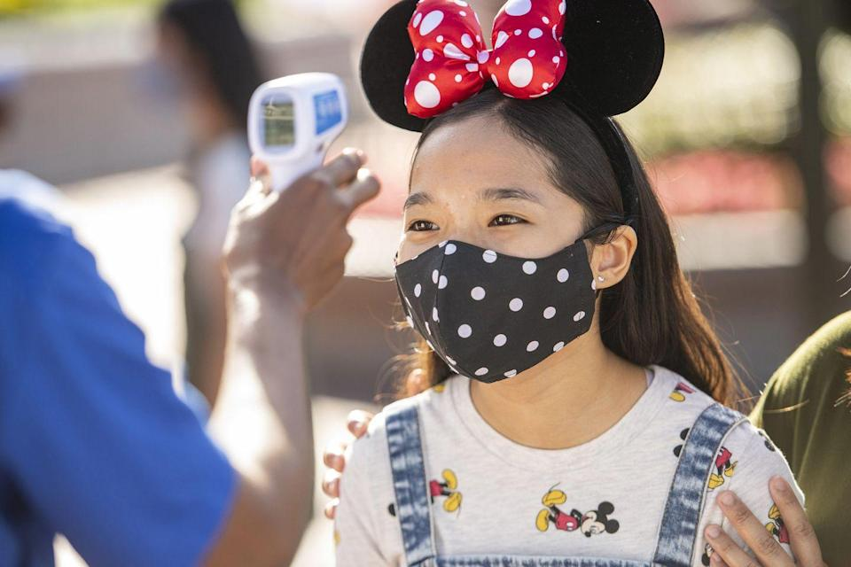 "<p>Many places opening up, like <a href=""https://www.cnbc.com/2020/07/04/how-six-flags-parks-plan-to-survive-the-coronavirus-pandemic.html"" rel=""nofollow noopener"" target=""_blank"" data-ylk=""slk:Six Flags"" class=""link rapid-noclick-resp"">Six Flags</a> and <a href=""https://disneyworld.disney.go.com/experience-updates/"" rel=""nofollow noopener"" target=""_blank"" data-ylk=""slk:Walt Disney World"" class=""link rapid-noclick-resp"">Walt Disney World</a>, are implementing temperature screenings at the gate, along with requiring pre-registering and reserving a time to visit. While <a href=""https://www.cnbc.com/2020/05/29/what-employers-can-legally-ask-about-coronavirus-in-return-to-work.html"" rel=""nofollow noopener"" target=""_blank"" data-ylk=""slk:temperature checks"" class=""link rapid-noclick-resp"">temperature checks</a> won't catch every asymptomatic person visiting or working there, as CNN reported, they might stop a few sick people from getting in and passing germs around to others. </p>"