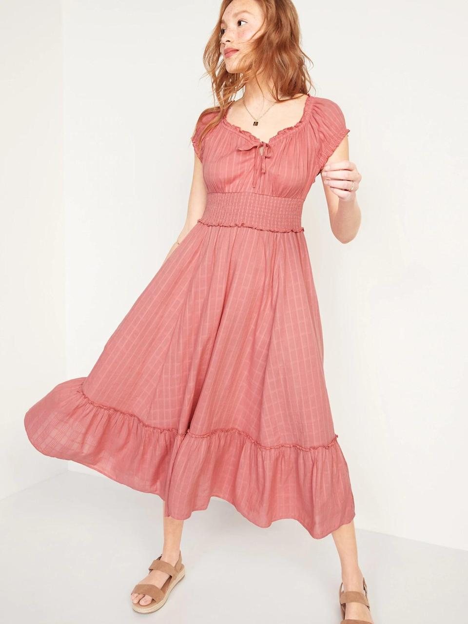 <p>We're loving the muted rose color of this <span>Old Navy Smocked Waist-Defined Dobby Midi Dress</span> ($45).</p>