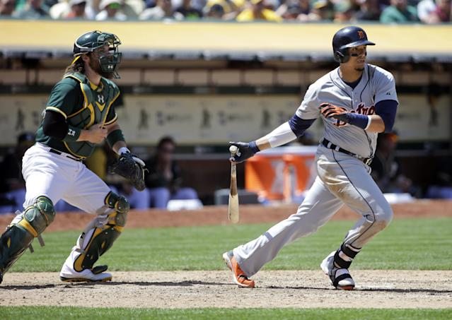 Detroit Tigers' Victor Martinez drives in two runs with a double against the Oakland Athletics during the seventh inning of a baseball game on Thursday, May 29, 2014, in Oakland, Calif. (AP Photo/Marcio Jose Sanchez)