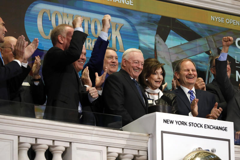 Dallas Cowboys owner, and major stockholder of Comstock Resources Jerry Jones, with wife Gene, is applauded as he rings the New York Stock Exchange opening bell, Wednesday, Sept. 4, 2019. The company is celebrating its $2.2 billion acquisition of Covey Park Energy. (AP Photo/Richard Drew)