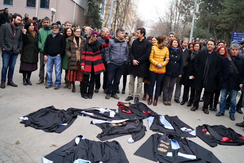 FILE PHOTO: Academics lay down their gowns during a protest against the dismissal of academics from universities following a post-coup emergency decree, in the Cebeci campus of Ankara University in Ankara