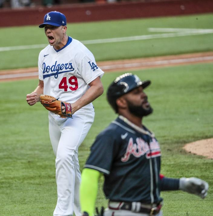 Dodgers reliever Blake Treinen celebrates after getting Atlanta's Marcell Ozuna, right, to fly out in the seventh inning.