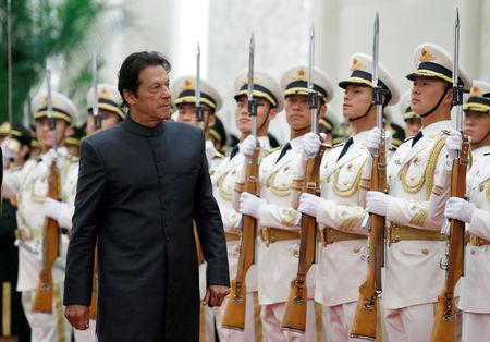 FILE PHOTO: Pakistani Prime Minister Imran Khan attends a welcome ceremony hosted by  China's Premier Li Keqiang at the Great Hall of the People in Beijing, China, November 3, 2018. REUTERS/Jason Lee/File Photo