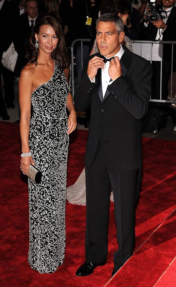 "George Clooney played with the paparazzi, while model girlfriend Sarah Larson stood silently by (as usual) in black and silver Giorgio Armani creation. Dmitrios Kambouris/<a href=""http://www.wireimage.com"" target=""new"">WireImage.com</a> - May 5, 2008"