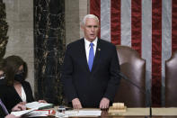 Vice President Mike Pence listens after reading the final certification of Electoral College votes cast in November's presidential election during a joint session of Congress after working through the night, at the Capitol in Washington, Thursday, Jan. 7, 2021. Violent protesters loyal to President Donald Trump stormed the Capitol Wednesday, disrupting the process. (AP Photo/J. Scott Applewhite, Pool)