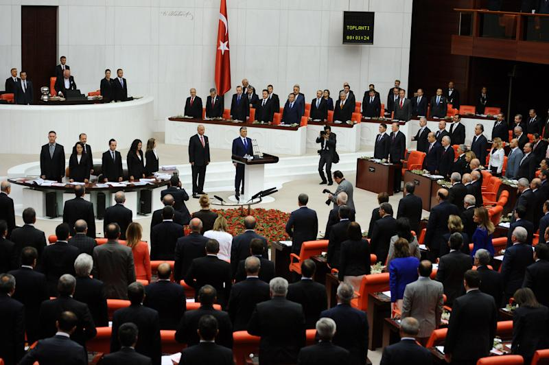 In this Monday, Oct. 1, 2012 photo, lawmakers and ministers, rear, listen to President Abdullah Gul, center, at Turkey's parliament in Ankara, Turkey. Turkey fired on Syrian targets for a second day Thursday, Oct. 4, 2012, but said it has no intention of declaring war, despite tensions after deadly shelling from Syria killed five civilians in a Turkish border town.Turkey's Parliament, meanwhile, began an emergency session to discuss a bill authorizing the military to launch cross border operations in Syria. If approved, the bill could more easily open the way to unilateral action by Turkey's armed forces inside Syria, without the involvement of its Western and Arab allies. (AP Photo)