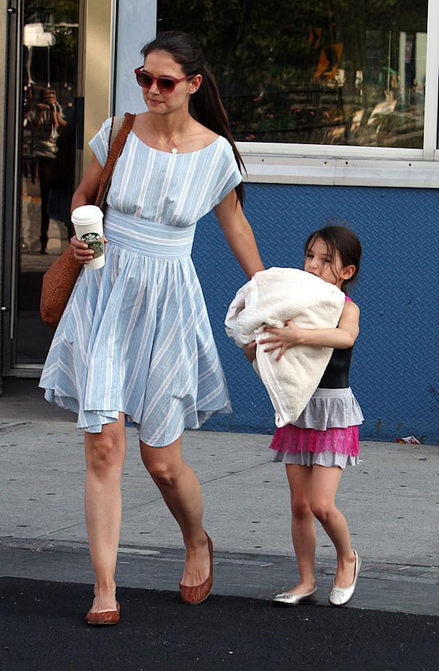 Fashionable mother and daughter duo Katie Holmes, 33, and Suri Cruise, 6, hit the streets of Manhattan to run some errands Thursday. First, Holmes scooped up her daughter from gymnastics class at Chelsea Piers Sports and Entertainment Complex, then the two headed to the grocery store. (6/21/2012)
