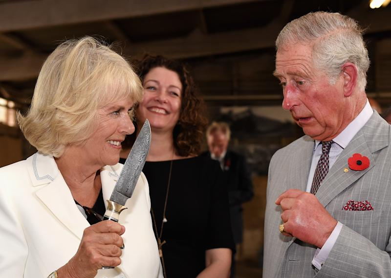 Camilla Parker Bowles wielding a knife in front of Prince Charles during a visit to Seppeltsfield Winery in Barossa Valley, Australia, November 2015.