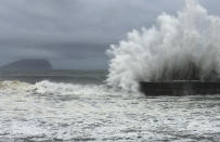 <p>As fast-moving Typhoon Nepartak makes its way across the Philippines Sea, large waves crash against the breakwaters in Ilan County, eastern coast of Taiwan, Thursday, July 7, 2016. (AP Photo/Johnson Lai) </p>