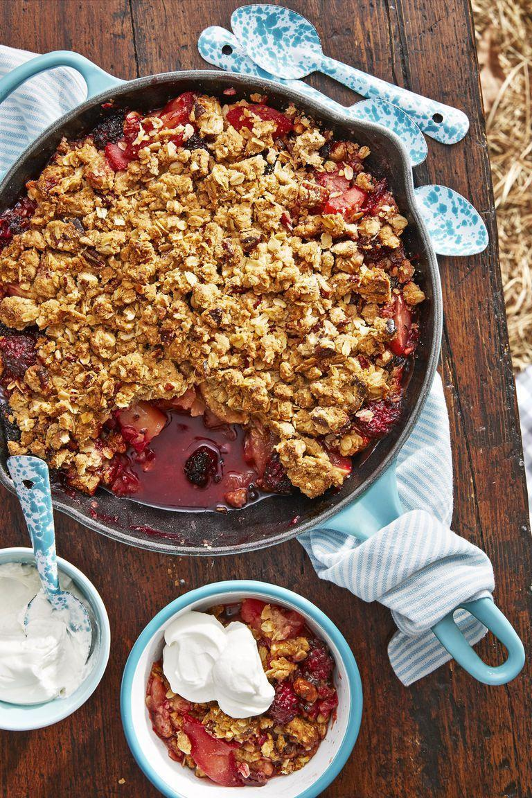 """<p>Chopped pecans and old-fashioned rolled oats make up the base of this crunchy crumble. When mixed with brown sugar, cinnamon, and cardamom, it makes this <a href=""""https://www.amazon.com/Pre-Seasoned-Cookware-Heat-Resistant-Stovetop-Induction/dp/B074XCWQS2?tag=syn-yahoo-20&ascsubtag=%5Bartid%7C10050.g.3290%5Bsrc%7Cyahoo-us"""" rel=""""nofollow noopener"""" target=""""_blank"""" data-ylk=""""slk:cast iron"""" class=""""link rapid-noclick-resp"""">cast iron</a> dish unforgettable. </p><p><strong><a href=""""https://www.countryliving.com/food-drinks/a22667478/cast-iron-apple-blackberry-crumble-with-sour-cream-whip-recipe/"""" rel=""""nofollow noopener"""" target=""""_blank"""" data-ylk=""""slk:Get the recipe"""" class=""""link rapid-noclick-resp"""">Get the recipe</a>.</strong></p><p><strong><a class=""""link rapid-noclick-resp"""" href=""""https://www.amazon.com/Pre-Seasoned-Cookware-Heat-Resistant-Stovetop-Induction/dp/B074XCWQS2?tag=syn-yahoo-20&ascsubtag=%5Bartid%7C10050.g.3290%5Bsrc%7Cyahoo-us"""" rel=""""nofollow noopener"""" target=""""_blank"""" data-ylk=""""slk:SHOP CAST IRON SKILLETS"""">SHOP CAST IRON SKILLETS</a><br></strong></p>"""