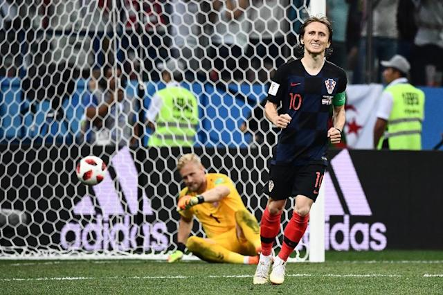 Croatia's midfielder Luka Modric celebrates after scoring in the penalty shootout during their Russia 2018 World Cup round of 16 match against Denmark, in Nizhny Novgorod, on July 1 (AFP Photo/Jewel SAMAD)