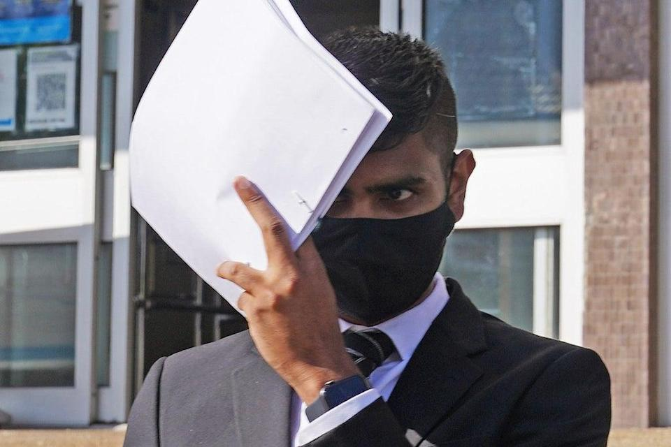 Javed Saumtally covers up as he leaves Hove Crown Court where he is charged with perverting the course of justice (PA) (PA Wire)