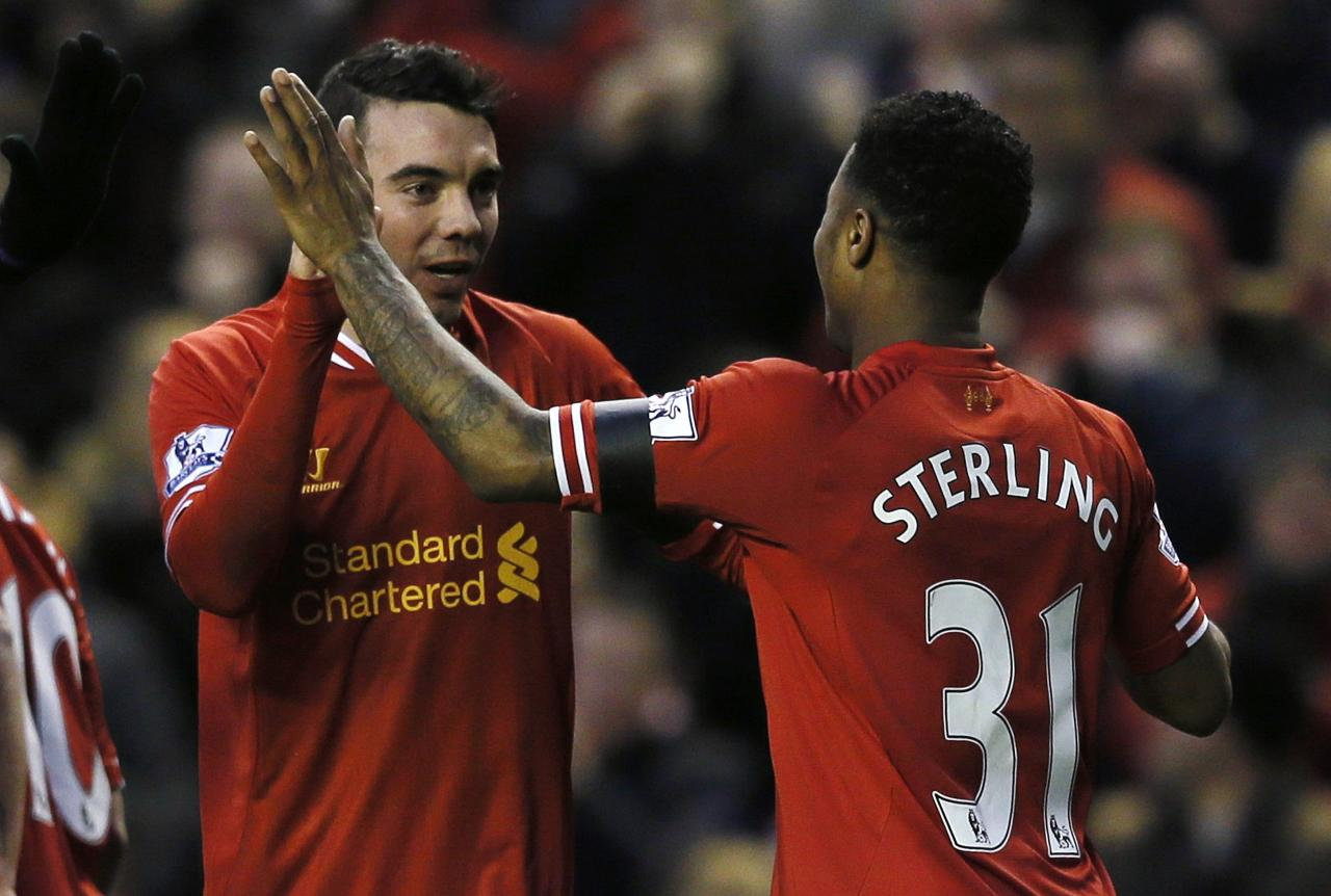 Liverpool's Iago Aspas celebrates his goal with teammate Raheem Sterling during their FA Cup third round soccer match against Oldham Athletic at Anfield in Liverpool January 5, 2014. REUTERS/Phil Noble (BRITAIN - Tags: SPORT SOCCER)
