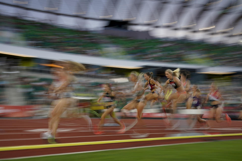 Runners compete in the women's 3000-meter steeplechase at the U.S. Olympic Track and Field Trials Thursday, June 24, 2021, in Eugene, Ore. (AP Photo/Ashley Landis)