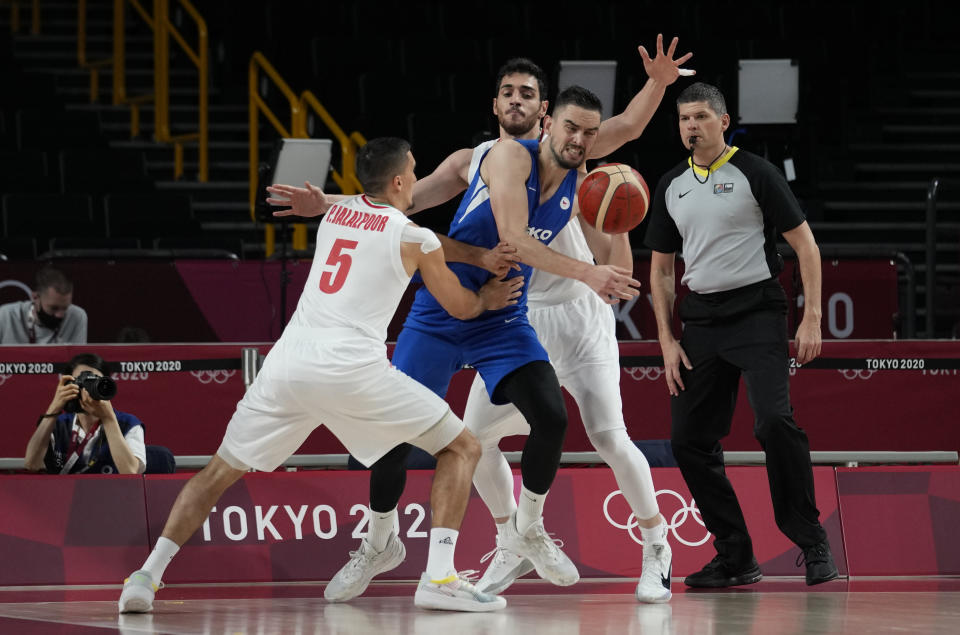 Czech Republic's Tomas Satoransky, second left, fights for the ball with Iran's Pujan Jalalpoor (5) during men's basketball game at the 2020 Summer Olympics, Sunday, July 25, 2021, in Saitama, Japan. (AP Photo/Eric Gay)