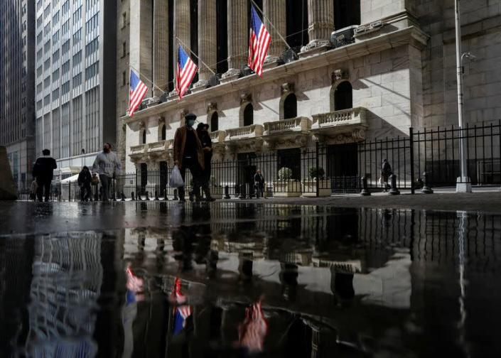 U.S. flags fly out in front of the NYSE is seen in New York