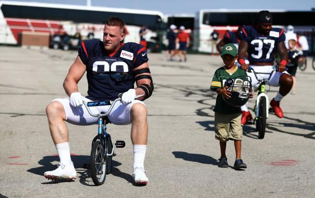 Wisconsin native J.J. Watt briefly rode a tiny bike to a Texans-Packers joint practice — until he broke the seat of the bike. (Packers/Twitter)