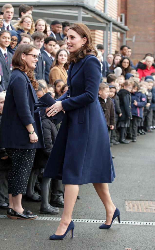 <p>On January 10th 2018, the Duchess of Cambridge kick-started her official royal duties with a visit to the Reach Academy Feltham. For the momentous occasion, Kate Middleton donned a blue coat by Hobbs over a £65 maternity dress by Seraphine. Though it isn't the first time the royal has donned the look, as she first wore the dress while pregnant with Princess Charlotte. <em>[Photo: Getty]</em> </p>