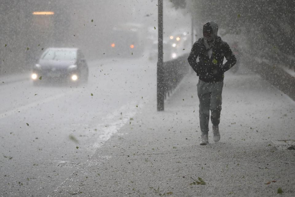 <p>Hail fell on the streets of London</p> (PA Wire)