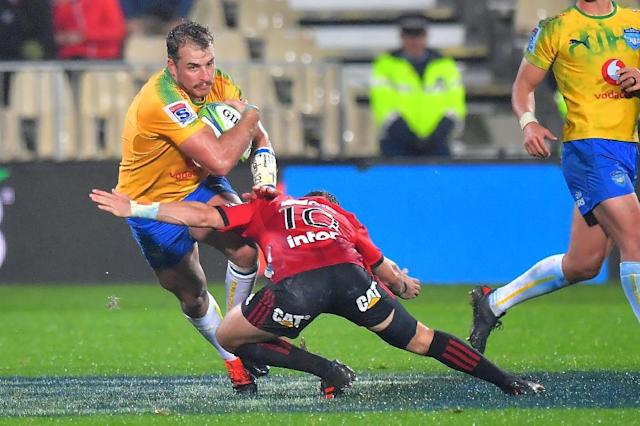 Bulls' captain Burger Odendaal (left) is tackled by Crusaders' Mitchell Hunt as the South Africans went down to defeat in Christchurh (AFP Photo/Marty MELVILLE)