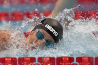 Federica Pellegrini of Italy swims in a heat during the women's 200-meter freestyle at the 2020 Summer Olympics, Monday, July 26, 2021, in Tokyo, Japan. (AP Photo/Martin Meissner)