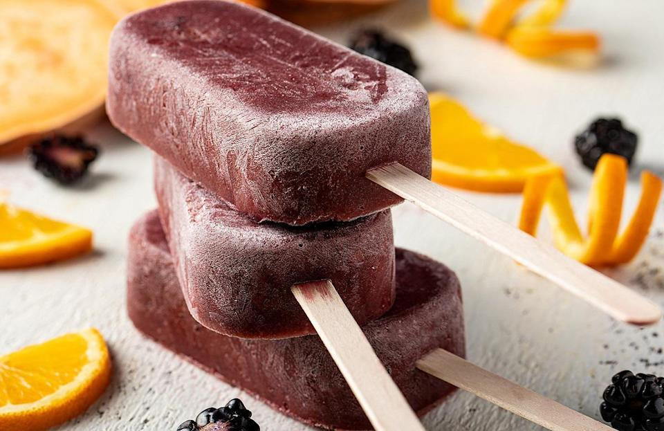 """<p>Cool down this summer with this <a href=""""https://www.thedailymeal.com/cook/dessert-recipes-frozen-fruit?referrer=yahoo&category=beauty_food&include_utm=1&utm_medium=referral&utm_source=yahoo&utm_campaign=feed"""" rel=""""nofollow noopener"""" target=""""_blank"""" data-ylk=""""slk:amazing frozen fruit dessert"""" class=""""link rapid-noclick-resp"""">amazing frozen fruit dessert</a>, which uses sweet potatoes, blackberries, lemon and orange juice. It's a crazy combination, but it works.</p> <p><a href=""""https://www.thedailymeal.com/best-recipes/blackberry-sweet-potato-ice-pops?referrer=yahoo&category=beauty_food&include_utm=1&utm_medium=referral&utm_source=yahoo&utm_campaign=feed"""" rel=""""nofollow noopener"""" target=""""_blank"""" data-ylk=""""slk:For the Blackberry Sweet Potato Ice Pops recipe, click here."""" class=""""link rapid-noclick-resp"""">For the Blackberry Sweet Potato Ice Pops recipe, click here.</a></p>"""