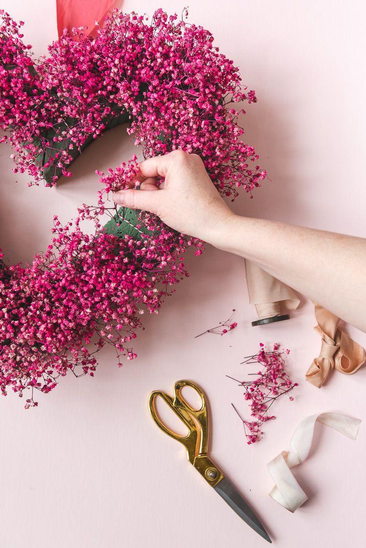 """<p>Often used as filler in floral bouquet, baby's breath becomes the star of the show when painted red or pink. </p><p><a class=""""link rapid-noclick-resp"""" href=""""https://www.amazon.com/Premium-Floral-Bricks-Styrofoam-Blocks/dp/B0847T3JQW/?tag=syn-yahoo-20&ascsubtag=%5Bartid%7C10055.g.2020%5Bsrc%7Cyahoo-us"""" rel=""""nofollow noopener"""" target=""""_blank"""" data-ylk=""""slk:SHOP FLORAL FOAM"""">SHOP FLORAL FOAM</a></p><p><em><a href=""""https://thehousethatlarsbuilt.com/2020/02/valentines-babys-breath-heart-wreath.html/"""" rel=""""nofollow noopener"""" target=""""_blank"""" data-ylk=""""slk:Get the tutorial at The House That Lars Built »"""" class=""""link rapid-noclick-resp"""">Get the tutorial at The House That Lars Built » </a></em></p><p><strong>RELATED:</strong> <a href=""""https://www.goodhousekeeping.com/holidays/valentines-day-ideas/g1132/diy-valentines-day-wreaths/"""" rel=""""nofollow noopener"""" target=""""_blank"""" data-ylk=""""slk:The Best Valentine's Day Wreaths to DIY"""" class=""""link rapid-noclick-resp"""">The Best Valentine's Day Wreaths to DIY </a><br></p>"""