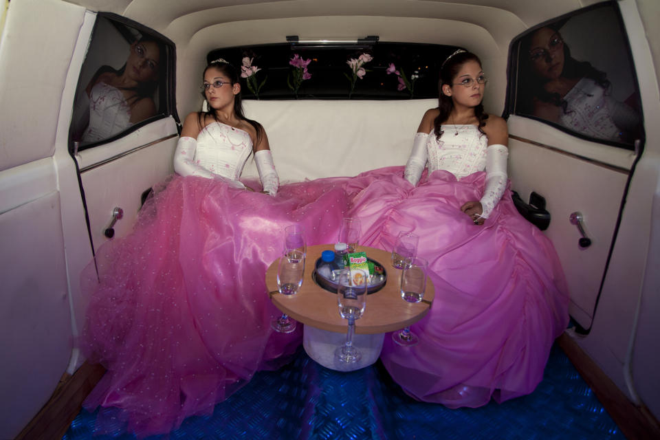 """The twins Laura and Beln on the day of their fifteenth birthday celebration. In Latin America, the celebration of the fifteenth birthday of a teenager is very important because it marks the transition from childhood to maturity. (Myriam Meloni, Italy, Finalist, Arts and Culture, Professional Competition, 2013 Sony World Photography Awards) <br> <br> <a href=""""http://worldphoto.org/about-the-sony-world-photography-awards/"""" rel=""""nofollow noopener"""" target=""""_blank"""" data-ylk=""""slk:Click here to see the full shortlist at World Photography Organisation"""" class=""""link rapid-noclick-resp"""">Click here to see the full shortlist at World Photography Organisation</a>"""
