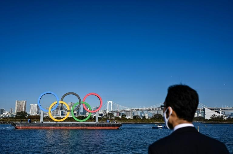 Ringing the changes: the Olympic logo was removed from the waterfront in Tokyo before being reinstalled at the start of December