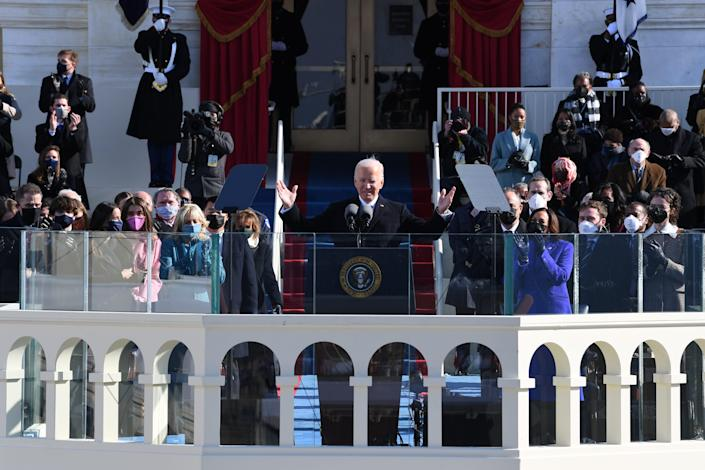 President Joe Biden waves to the crowd after being sworn in during the 2021 Presidential Inauguration of President Joe Biden and Vice President Kamala Harris at the U.S. Capitol.