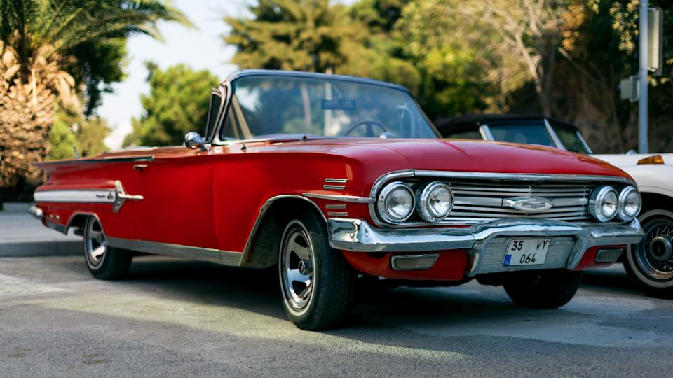 Izmir, Turkey - September 23, 2018: Front view of a red colored 1960 Chevrolet Impala.