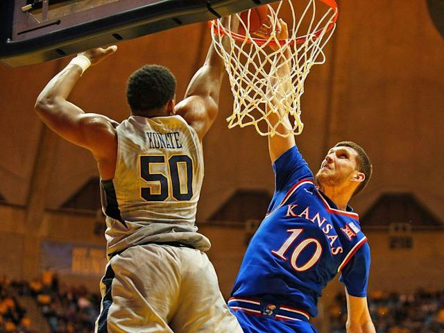 "<p>The legend of Konate took flight the way many things do in sport these days. </p><p>Via gif.</p><p>Actually, in Konate's case, it started with a series of gifs that came in a flurry on a Monday night in Morgantown when No. 10 Kansas visited No. 6 West Virginia. Sagaba Konate's first rejection came on a fast break 38 seconds into the game. Less than 30 seconds later, Konate swatted another Jayhawks lay-up attempt away. Then, on a two-on-one fast break, Svi Mykhailiuk tried to posterize the sophomore center who was positioned under the basket and met Mykhailiuk at the rim with a two-handed block volleyball style stuff. Mitch Lightfoot tried Konate two minutes later and he, too, got denied. His fifth of the first half came when KU's Marcus Garrett soared in from the right wing only to get shut down with another two-handed block.</p><p>Kansas players shouldn't feel deflated. Konate, as the last line of defense to the vaunted Press Virginia attack, has done similar to the rest of college basketball as the Mountaineers roared into the Sweet 16 after blowing out both Murray State and Marshall. His 3.3 blocks per game ranks third in the country. It's an eye-opening stat especially considering that he is the shortest player among the nation's leaders in blocked shots.</p><p>WVU assistant coach Erik Martin, aka the ""Sags Whisperer,"" who works with the Mountaineer big men, calls Konate a unique talent. A member of the Cincinnati 1992 Final Four team, Martin said he's never been around a player with such uncanny timing as a shot-blocker. </p><p>""He's explosive but we've had better athletes,"" Martin says, adding that Konate doesn't have the freak of nature type of athleticism that former Cincy big man Kenyon Martin had. ""Kenyon had really elite (explosion). If you blink your eyes he's really up above the rim. I've been around and played all over the world, I've never seen anyone who had a quicker jump. Sags isn't like that. He's gonna gather himself. He's bigger than Kenyon and he has huge, strong mitts. I've never seen anybody block two-hand shots like that. I wasn't around with the Bill Russell era. It's one thing to block a guys dunk but to do it with two hands, that's just something you don't see. You know how much confidence you have to have to try and do that? A split second earlier or later and you're getting dunked on.</p><p>""Sags' blocks are at the rim which you rarely see anywhere because guys are always worried about getting dunked on. He's figured out a way to meet guys at that time.""</p><p>Asked how Konate's figured this out, Martin traces it back to the sophomore's upbringing in Mali, Africa. Konate grew up playing soccer and said he only started playing basketball in 2014.</p><p>""Last year, a guy from Texas (Jarrett Allen) dunked right on top of Sags,"" says Martin. ""It was like ESPN's Dunk of the Week. It didn't bother him one bit. Most kids who are raised in America would be (crushed).""</p><p>Konate doesn't get hung up dreading some kind of self-esteem stigma. </p><p>""For me, I just don't really get into those things. 'Oh, they're gonna dunk on me and I'm gonna be on <em>SportsCenter</em>.' I don't really care about that,"" he says. ""It's just a mindset. Whether you're gonna get dunked on or you're gonna block their shot, it's out of my mind if they dunk on me. It's behind me. I got dunked on so many times last year. I learn from it. This year, it's a lot less.</p><p>""That was how I was raised. I grew up with 13 brothers and sisters. It was more competitive. My brother and my dad always told me, the past is the past. You just gotta keep it going forward."" </p><p>Konate has come a long way indeed. </p><p>Like Jevon Carter, who last season won national defensive player of the year honors, Konate came to Morgantown as an unheralded recruit. Like five of his brothers, Konate—one of 14 children—came to the U.S. to pursue education and basketball opportunities. He played at a Class A high school near the Pennsylvania-Ohio border. </p><p>""There weren't a whole lot of people recruiting him,"" says Larry Harrison, the WVU assistant who recruited him. ""He played for a local AAU team, played for a small high school, so he didn't have a lot of exposure. Wichita State, Penn State recruited him. Pitt just didn't recruit him. We had friend who went to Walsh College when Huggs (Bob Huggins) was the coach there. He called me and said there was a kid that I needed to take a look at.""</p><p>After Harrison returned from watching Konate play, Harrison admitted to Huggins that he wasn't sure how good the prospect was. But he was big and he was very athletic and they should keep recruiting him.</p><p>""In high school he wasn't blocking shots like this, but now the way he's blocking shots, it's become his art,"" says Harrison.</p><p>Konate's development is rooted in the same place that many other Mountaineer sleeper success stories are—the weight room. In less than two years, he's re-shaped his physique and packed on almost 20 pounds. He's now 258 pounds.</p><p>""I remember giving him 30-pound dumbbells and I thought he was gonna drop 'em on his face,"" says Andy Kettler, WVU's strength coach. ""The idea was simple. Teach accountability. Teach him to work hard. Just keep it simple. Take a handful of simple things and build on it.""</p><p>Konate now can do single-arm bench press with 115-pounders for sets of 10. Kettler says Konate's vertical jump also is well over 35 inches.</p><p>""My thing to him is he's 6'8"", not 7'0"". 'You need to become the strongest player in the country so that you can separate yourself against those 6'11"" guys,' because he is our center.""</p><p>Fran Fraschilla was calling that Texas-WVU game last season when Konate was on the wrong end of ESPN's Dunk of the Week.</p><p>""That was me,"" says Fraschilla. ""I was screaming, 'THE DUNK OF THE YEAR! THE DUNK OF THE YEAR!!'"" But it just rolled off (Konate's) back. He has a pride in blocking shots. If you dunk on me, great. It's very similar to what we remember about (Dikembe) Mutombo and (Patrick) Ewing. It's not something to show somebody up. It's more this is my thing. Every great shot blocker has to have pride in blocking shots. It becomes part of their identity. 'You may score on me but I'm waiting for you to come at me again.'""</p><p>Fraschilla also credits Martin—the ""Sags Whisperer"" for also helping develop him into a capable low-post scorer and managing his emotional on-court fire in a young player that has a bit of a temper. </p><p>Fraschilla, who has spent 39 years in coaching and broadcasting basketball, says there are four elements to what he describes as the art of shot-blocking.</p><p>• Pride</p><p>• Body Positioning</p><p>• Timing </p><p>• Instinct</p><p>In regards to Konate's body positioning, Fraschilla has observed that the WVU big man, if he's not going for the two-handed rejection, always tries to block the ball with his inside hand (the one closest to the rim) depending on which side the offensive player is coming from, to keep his body away and eliminate body contact. From a timing perspective, Konate never leaves his feet before the offensive player does, Fraschilla says. ""He has a great ability to stay vertical.""</p><p>Despite the penchant for two-handed blocks, Konate never played volleyball growing up.</p><p>""My teammates say, 'Sags you block the ball and it goes out of bounds. You gotta grab it or tip it to us.' I said, 'Oh, yeah, that sounds really good.'""</p><p>Konate says he likes to watch film of Ben Wallace, an undersized post player who became a four-time NBA Defensive Player of the Year. Asked where his timing comes from, Konate says he just doesn't know.</p><p>""It might be natural,"" he says. ""It's just a mindset.""</p>"