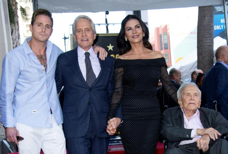 (L-R) Cameron Douglas, Michael Douglas, Catherine Zeta-Jones and Kirk Douglas in November 2018 at a ceremony unveiling a star on the Hollywood Walk of Fame for Michael Douglas
