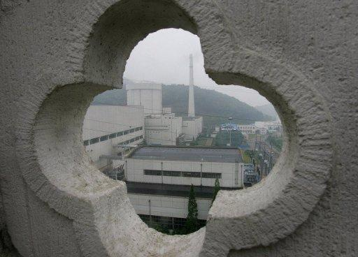 A view of a nuclear power plant as seen through designs from a hilltop structure in 2005