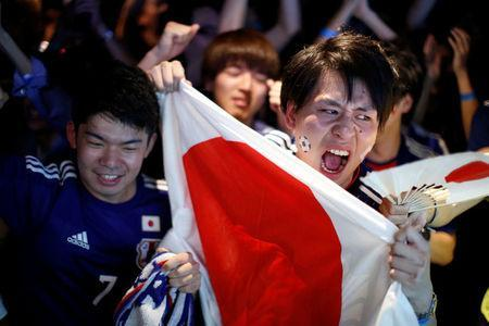 Japanese fans react after Japan's first goal against Senegal as they watch a broadcast of the World Cup Group H soccer match Japan vs Senegal, at a sports bar in Tokyo, Japan June 25, 2018. REUTERS/Issei Kato