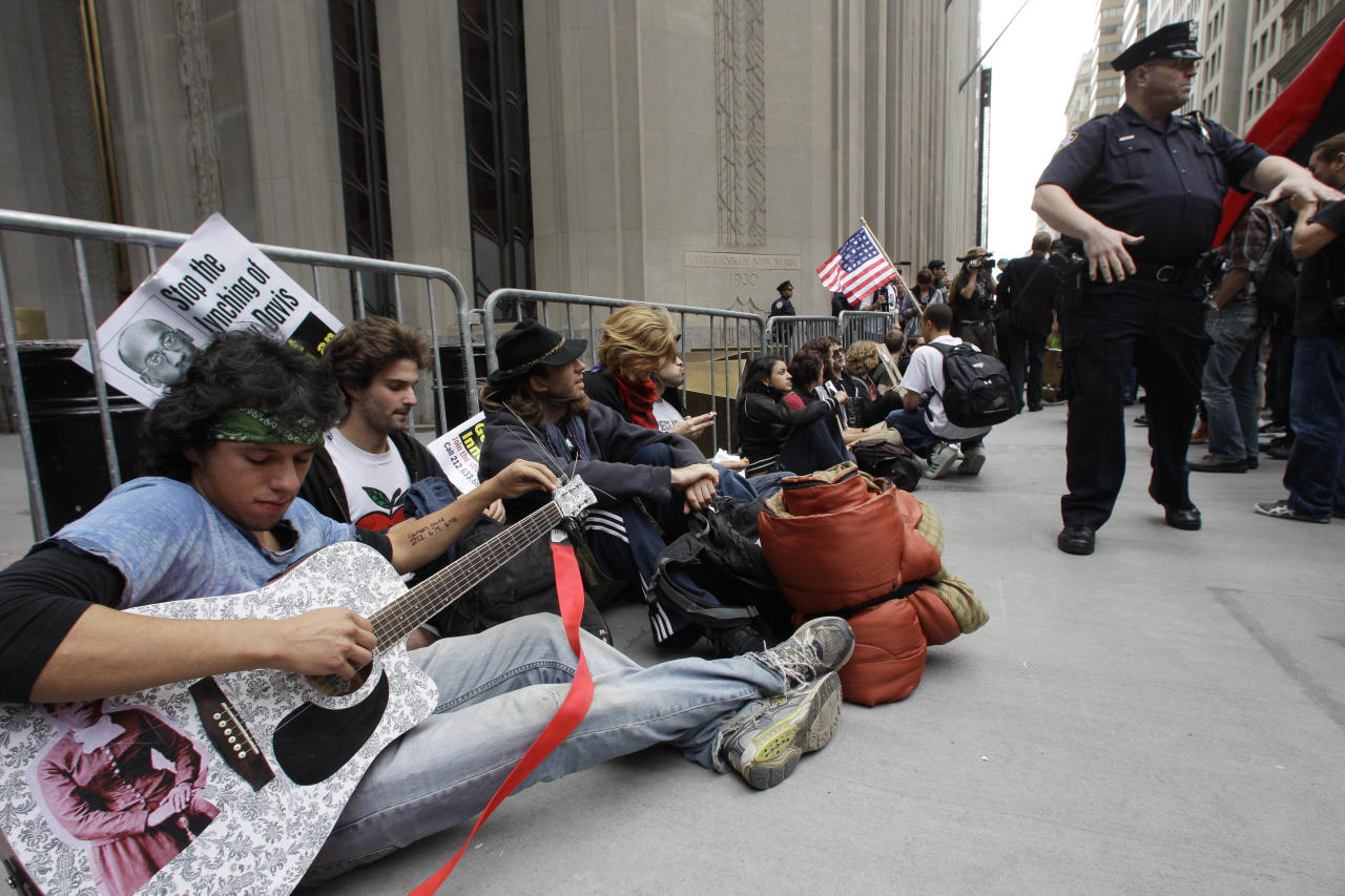 FILE - In this Sept. 17, 2011 file photo, demonstrators affiliated with the Occupy Wall Street movement gather to call for the occupation of Wall Street in New York. Monday, Oct. 17, 2012 marks the one-year anniversary of the Occupy Wall Street movement. (AP Photo/Frank Franklin II, File)