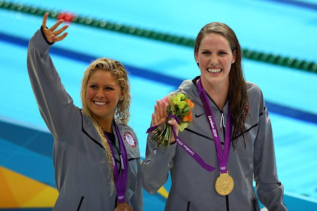 LONDON, ENGLAND - AUGUST 03: Gold medallist Missy Franklin of the United States and bronze medallist Elizabeth Beisel of the United States celebrate following the medal ceremony for the Women's 200m Backstroke Final on Day 7 of the London 2012 Olympic Games at the Aquatics Centre on August 3, 2012 in London, England. (Photo by Paul Gilham/Getty Images)