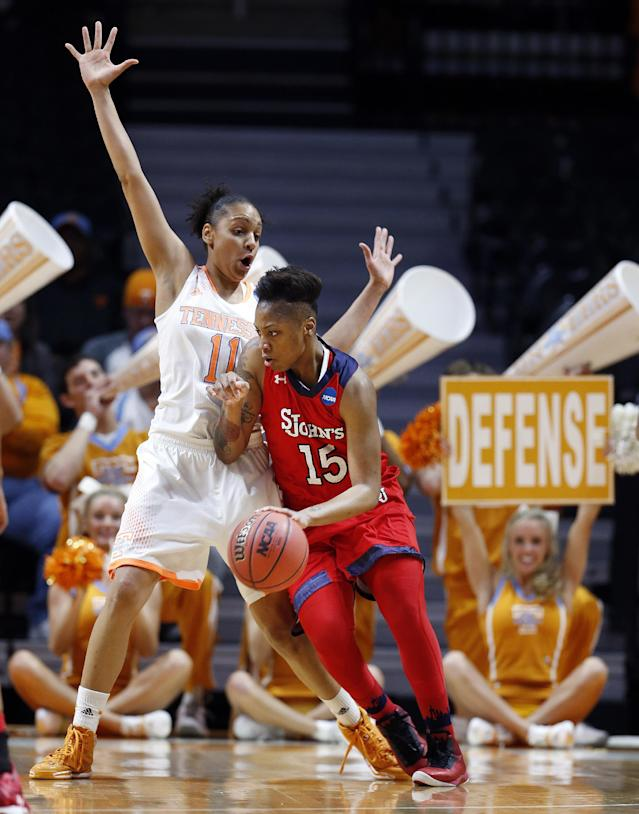 St. John's guard Danaejah Grant (15) drives against Tennessee forward Cierra Burdick (11) in the first half of an NCAA women's college basketball second-round tournament game Monday, March 24, 2014, in Knoxville, Tenn. (AP Photo/John Bazemore)