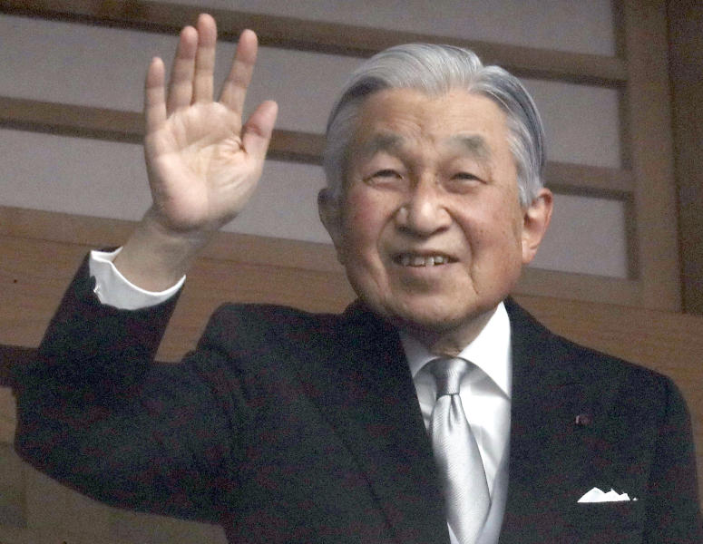 Japan's Emperor Akihito waves to well-wishers as they appear on the balcony of the Imperial Palace to mark the emperor's 85th birthday in Tokyo Sunday, Dec. 23, 2018. Emperor Akihito, marking his birthday — his last before his upcoming abdication — said he feels relieved that his reign is coming to an end without having seen his country at war and that it is important to keep telling younger people about his nation's wartime history.(AP Photo/Eugene Hoshiko)