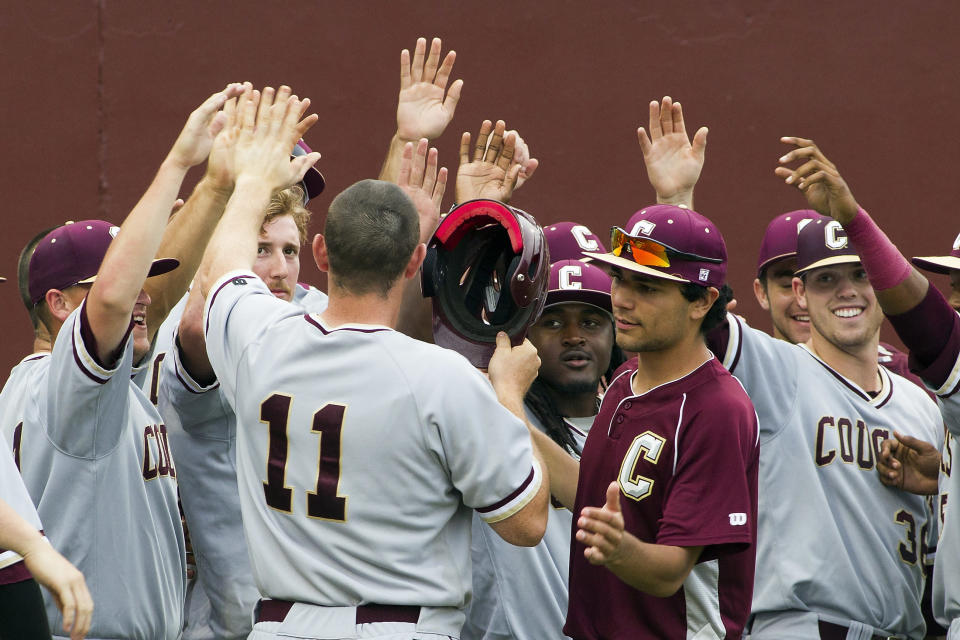 After a six-hour weather delay, College of Charleston's Nick Pappas, center, is congratulated on his home run against Auburn at the Tallahassee Regional of the NCAA college baseball tournament in Tallahassee, Fla., Sunday, May 31, 2015. (AP Photo/Mark Wallheiser)