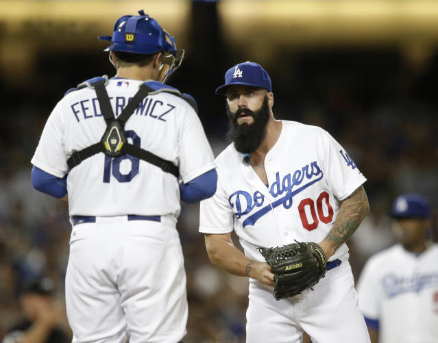 Los Angeles Dodgers relief pitcher Brian Wilson, right, talks to catcher Tim Federowicz during the eighth inning of an MLB National League baseball game against the San Diego Padres on Saturday, Aug. 31, 2013, in Los Angeles. The Dodgers won 2-1. (AP Photo/Jae C. Hong)