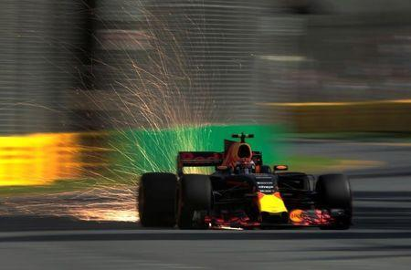 Formula One - F1 - Australian Grand Prix - Melbourne, Australia - 25/03/2017 Red Bull Racing driver Max Verstappen of the Netherlands showers sparks from his car during the third practice session. REUTERS/Jason Reed